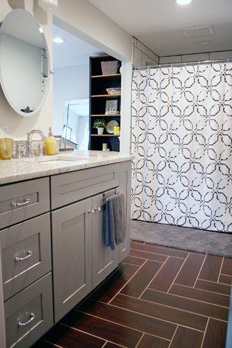 At Home Master Bathroom Renovation Complete Gray Vanity Herringbone Floor Thomasville Baltic