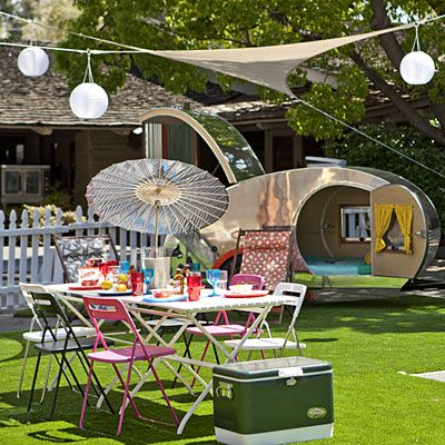 Camping never looked so stylish    A streamlined teardrop trailer, hanging lanterns, mod shade structure set the scene at Sunset's Menlo Park headquarters.    Table, chairs, and lanterns from Ikea. Cooler by Coleman. Umbrella by Brelli. Deck chairs by Gallant & Jones. Teardrop trailer by Vacations-in-a-Can. Shade structure by Aaron Jones. Turf by SYNLawn.