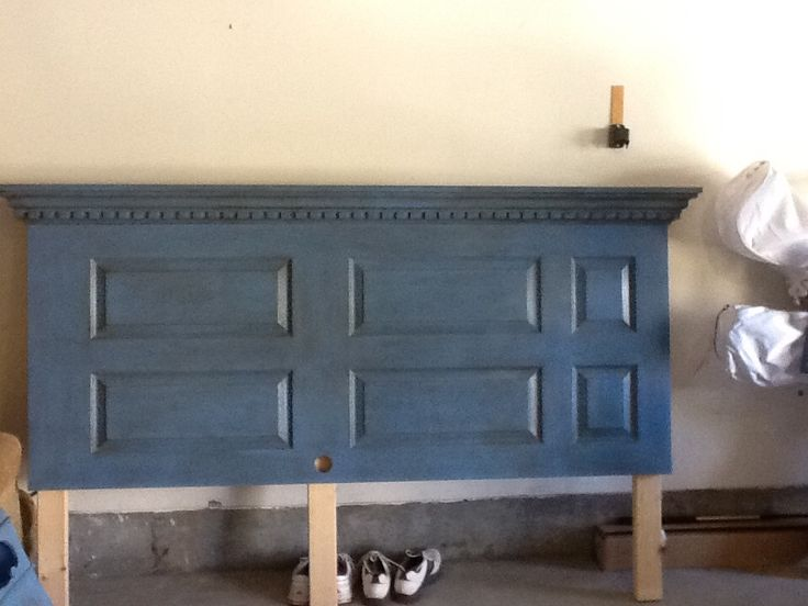 Turn an 6-panel door into a King Headboard with Chalkpaint, dark wax, and some crown moulding.