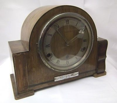 Larger Mantel Clock Fair condition should be seen as a restoration project. Working but unable to test time keeping. Left hand front case moulding has fallen off, part of this is inside the clock bac