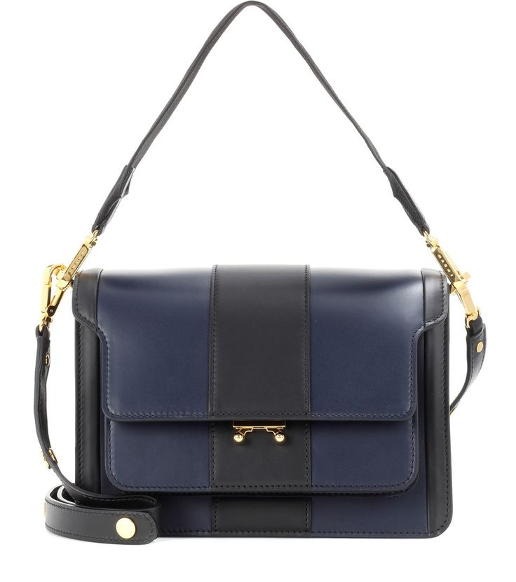 Marni - Trunk leather shoulder bag - Marni updates its coveted Trunk shoulder bag in navy blue and black. Crafted from smooth leather, the elegant style is complete with luxe golden hardware. The multiple compartments create a surprising amount of storage space without adding bulk to the silhouette. Style yours next to a black dress for a perfectly sophisticated off-duty look. seen @ www.mytheresa.com