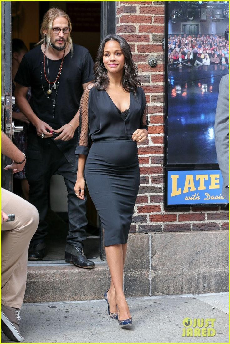 Zoe Saldana is followed closely behind by her husband Marco Perego while exiting the Ed Sullivan Theatre following an appearance on The Late Show with David Letterman on Wednesday (July 30) in New York City.