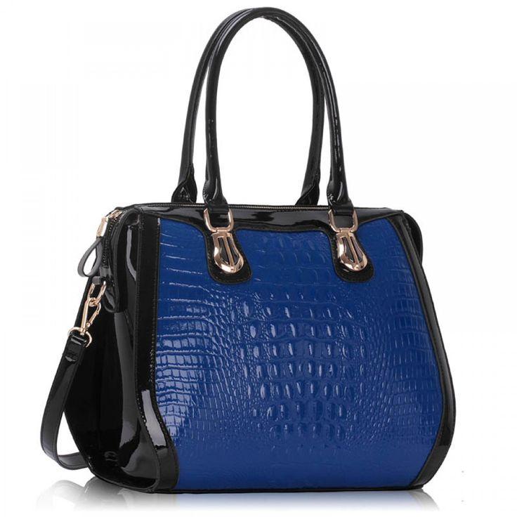 Prostorná a elegantní kabelka. Barva: černo-modrá. Velikost: 36,5 cm x 27 cm. Kabelka s pozlaceným kováním. Odnímatelný popruh pro nošení přes rameno.