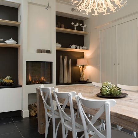 elevated firebox make sense in informal dining space.  tile floor allows not hearth and log storage.