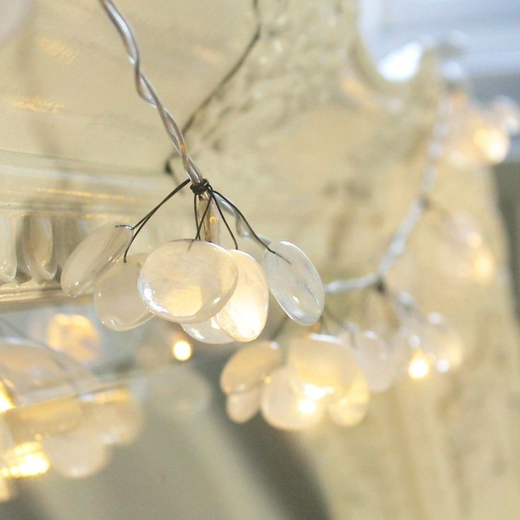 Add a little warmth and sparkle to you home this autumn and winter with our best selling glass fairy lights. These string lights are just too lovely to only have in your home for Christmas.Hang over a fire place, a mirror or a curtain pole to give an instant cosy feel. 10 LED bulbs are surrounded by cluster of 6 delicate handmade fused glass drops in soft white, pink, blue or clear glass. The glass fairy lights come carefully packaged in a gift box and beautifully finished...