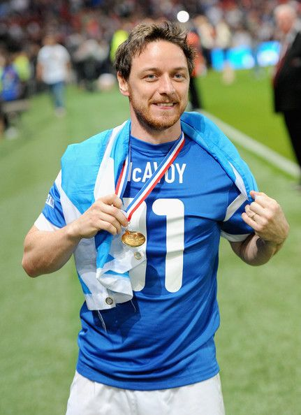 James McAvoy Photos - James McAvoy of the Rest of the World celebrates victory in the Soccer Aid 2014 match at Old Trafford on June 8, 2014 in Manchester, England. - Soccer Aid 2014