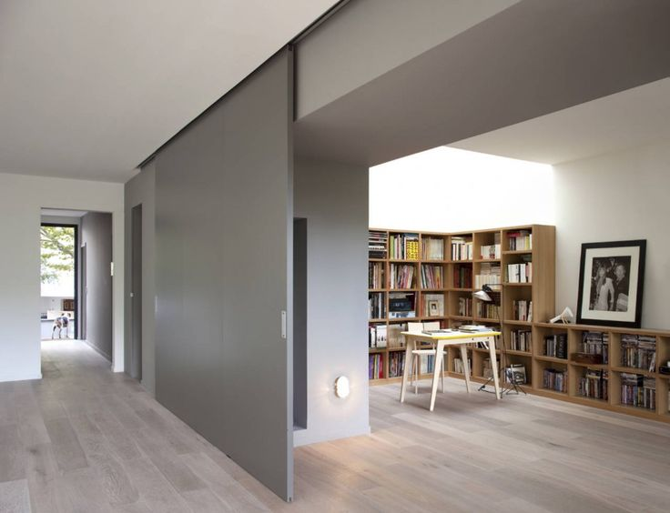 Sliding wall panel connects to the library