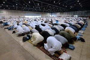 Marseille, France: Muslims pray in Parc Chanot hall.