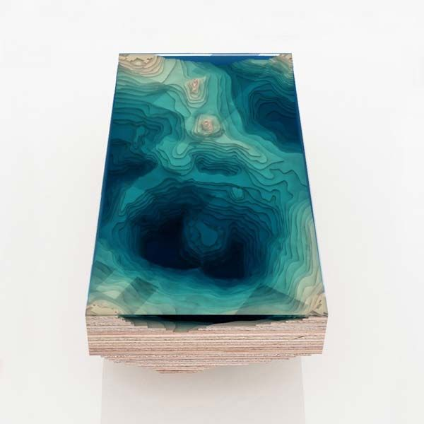 The Abyss Table – is an amazing nautical-themed coffee table that looks like ocean depths; I think this layered glass and wood table is a bit more work of art than it is a piece of furniture. Photos (c) Duffy London