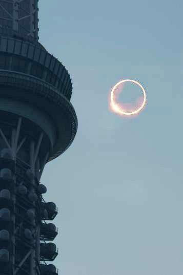 An annular eclipse is seen beside the Tokyo Sky Tree tower in Tokyo's Sumida Ward at 7:34 a.m. on May 21. This composite photo was created using different exposure levels taken at the same place. (Satoru Sekiguchi): Tokyo Sky, Composite Photo, Towers, Annular Eclipse, Place