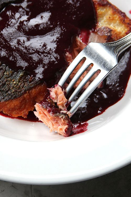 A simple, tart blackberry sauce adorns crispy salmon in this easy dish.
