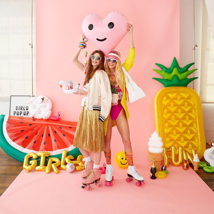 inflatable pineapple pool float on pink background