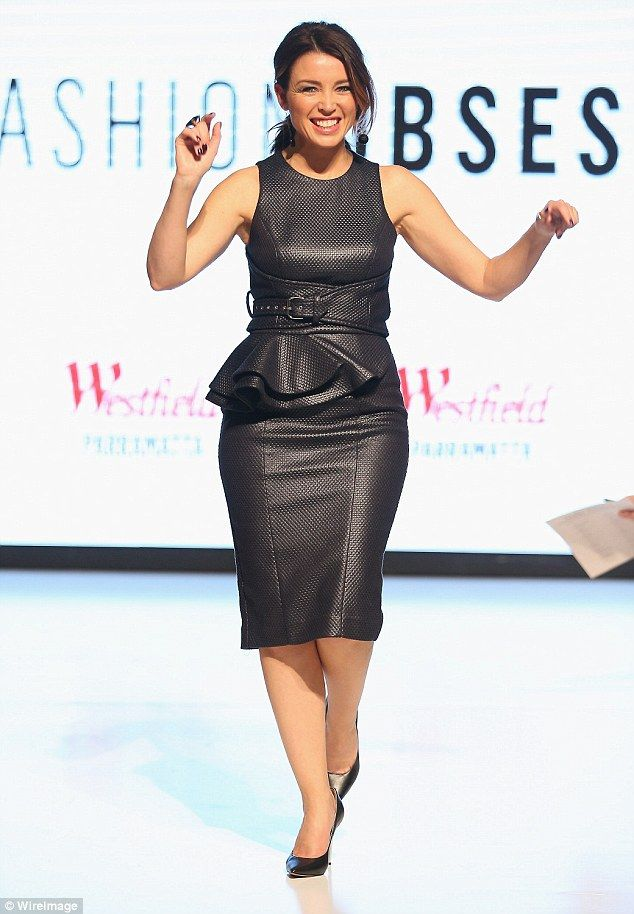 The new black: Dannii Minogue encouraged shoppers to try new season trends as she made an ...