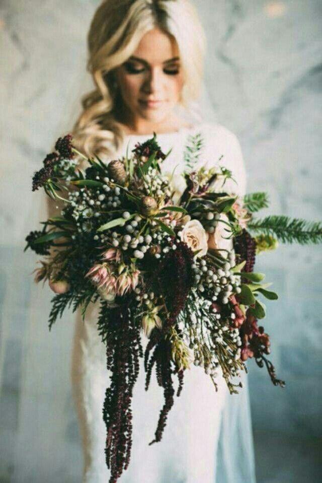 Lovely Cascading Winter Wedding Bouquet Featuring: Garnet Scabiosa, Deep Burgundy Amaranthus, Dusty Sand Roses, Blushing Bride Protea, Silver Brunia, Evergreen Foliage