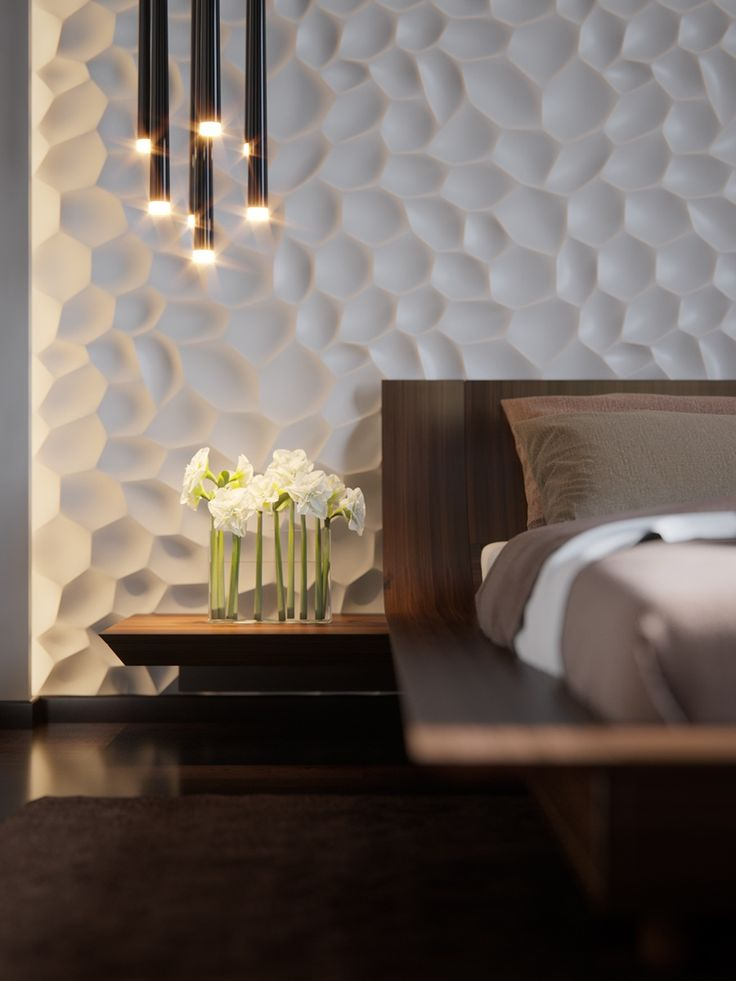 this bedroom is centered an incredibly intricate headboard wall illuminated by cove lighting on all sides
