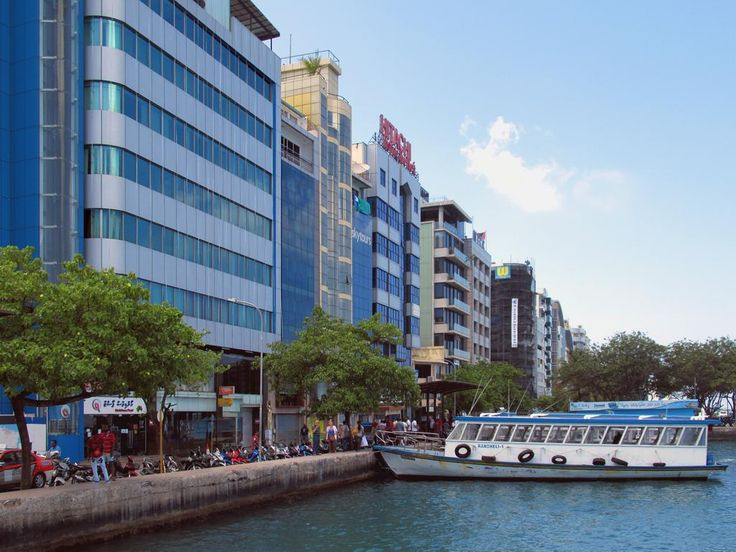 Highrise hotels, banks, and office buildings line the waterfront at Male, Maldives.