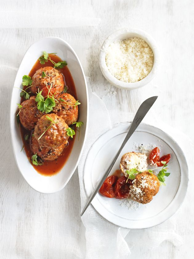 bocconcini-stuffed meatballs with tomato sauce?....these are soooo good, but bake them for 30 mins @ 180C instead of frying, then stick to the great recipe. Yummy