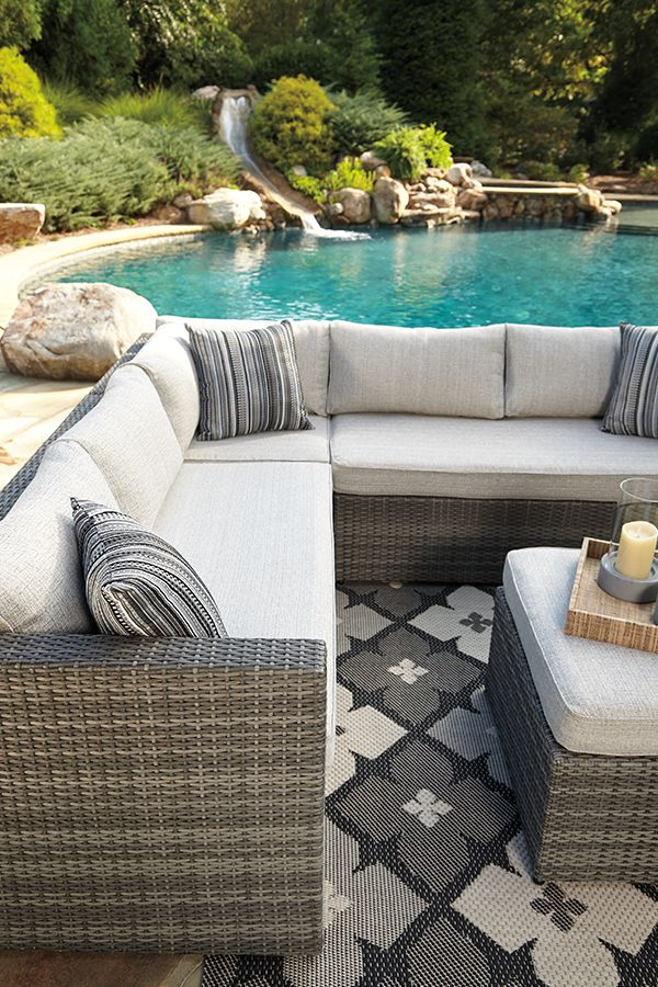 Drift away in the deeply cushioned comfort of this 4-piece outdoor sectional set. Sleek L-shape sectional and ottoman are made for entertaining, reading or taking a nap.