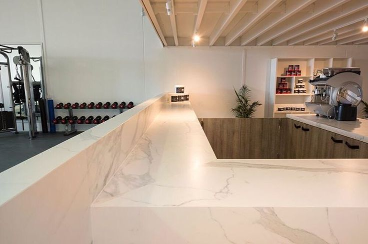 """189 Likes, 5 Comments - CDK Stone (@cdkstone) on Instagram: """"Neolith Estatuario is perfect for this gym, as it won't stain, scratch, fade or be affected by heat…"""""""