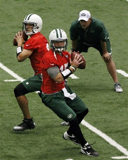 New York Jets quarterbacks coach Matt Cavanaugh, right, watches as Mark Sanchez, left, and Tim Tebow throw during NFL football practice in Florham Park, N.J., Tuesday, June 12, 2012. (AP Photo/Mel Evans): Sports News, Jet Quarterback, Quarterback Coaches, Tim Tebow, Florham Parks, Football Practice, New York Jet, Coaches Matte, Headlines News