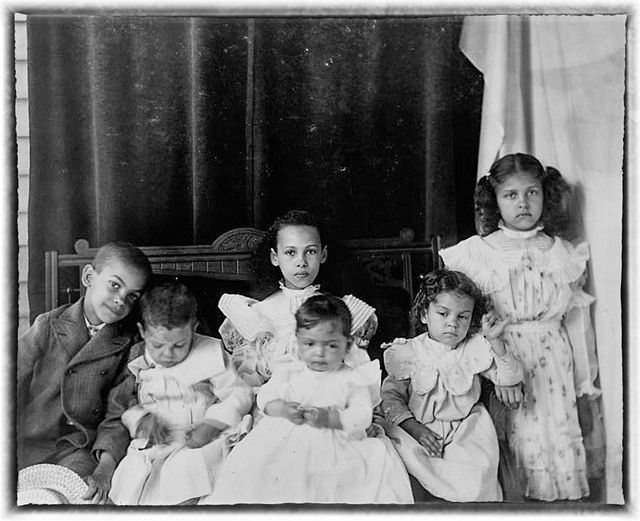Slave master's children conceived by slaves posed for Porch Portrait in Georgia in 1899