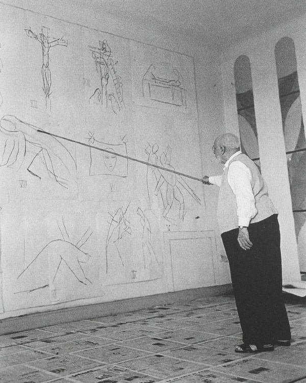 """Matisse drawing the Stations of the Cross with a bambu pole in the interior of the Chapelle de Rosaire at Vence. """"Drawing is like making an expressive gesture with the advantage of permanence."""" (Matisse)."""