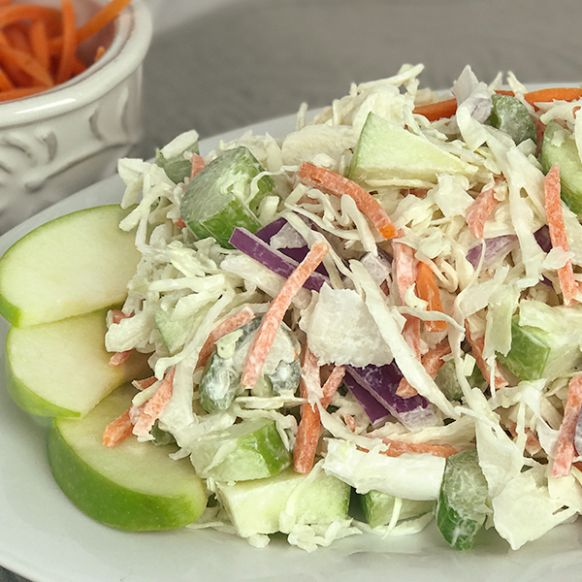Chiquita® Green Apple Bites and our coleslaw are perfect partners with a freshly-whisked dressing.