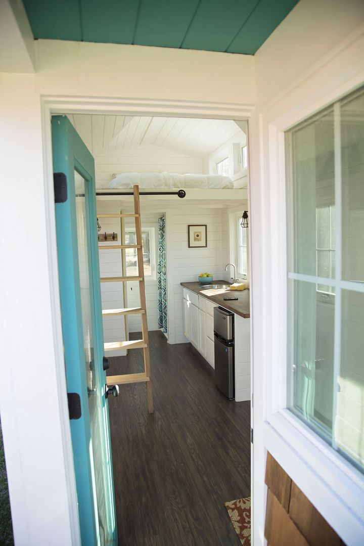 Nice touches of color in this custom tiny house on wheels.
