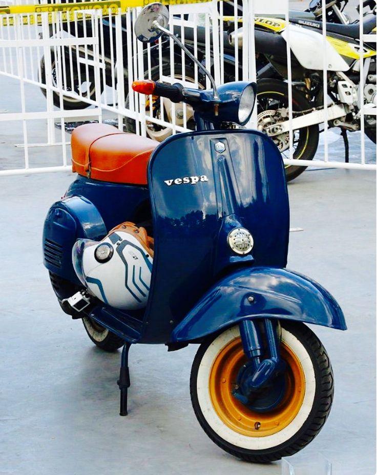 A beautiful vintage Vespa Primavera scooter in dark blue