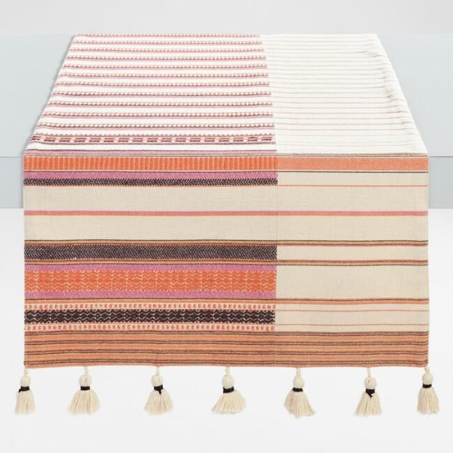 Our Exclusive Natural Cotton Table Runner Features Woven Stripes In Soft Desert Hues Of Orange Pink And Gray And Natural Table Linens Table Runners Pink Table
