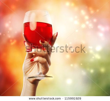 Woman holding a wine glass on abstract background (celebration) - stock photo