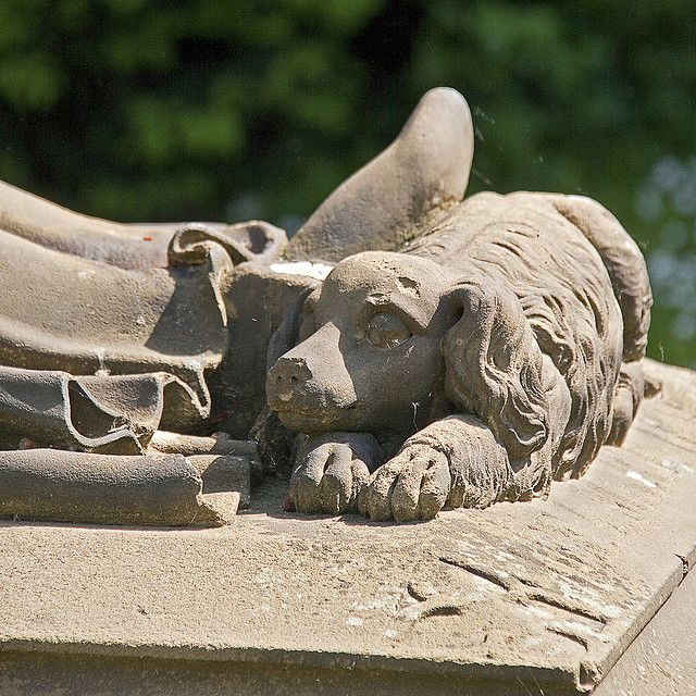 Statue of faithful dog at feet of his master in main cemetery in Frankfurt, Germany....Photo by Neil Gallop