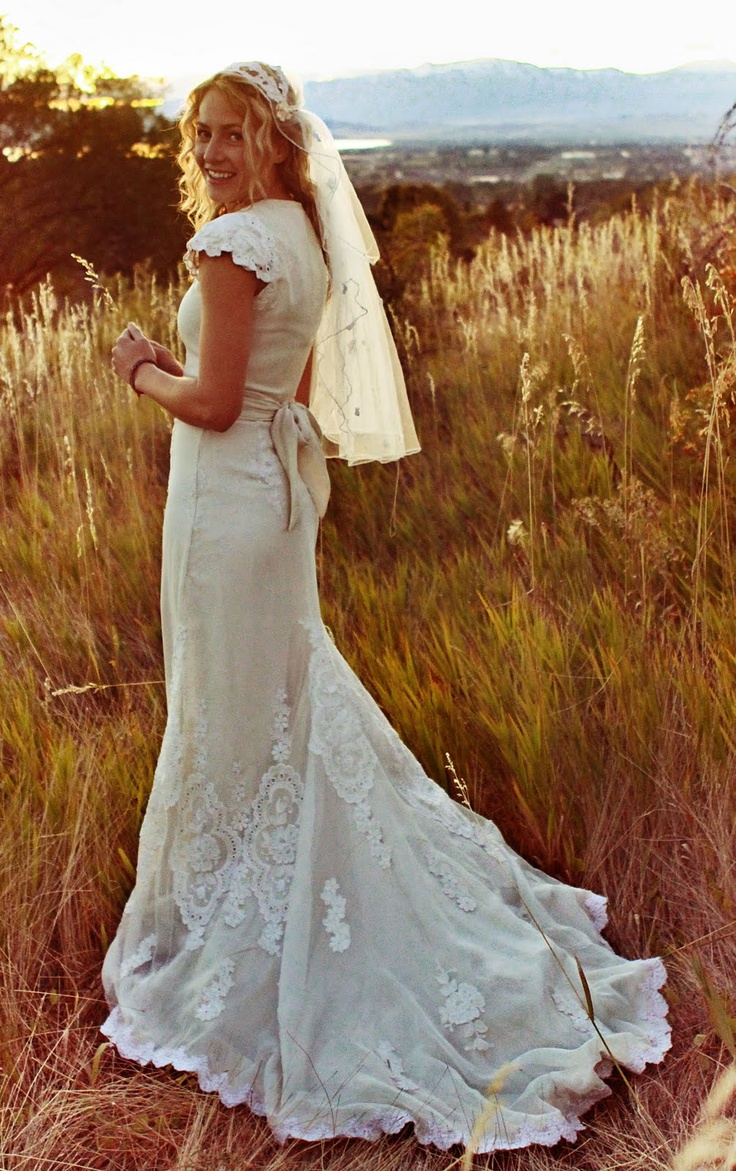 DIY wedding dress!! Can you believe she actually made this out of window linen?!