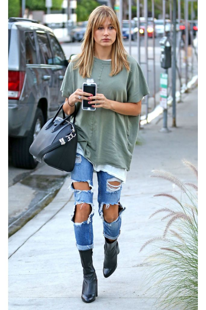 Hailey Baldwin fashion ~ ripped jeans + oversized green weather + heels