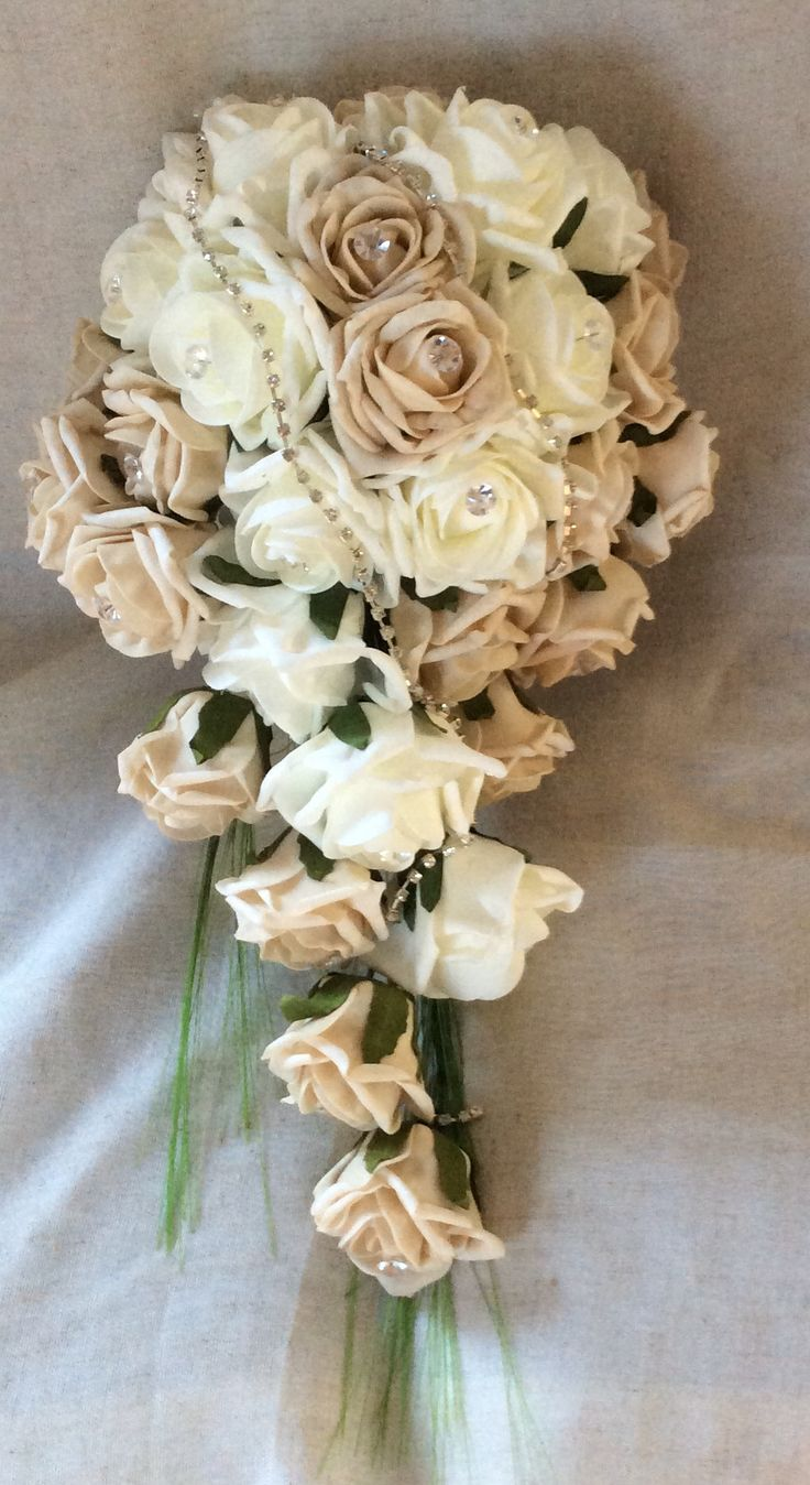 Ivory and mocca poly foam roses with crystal pins and diamante by Cathey's flowers