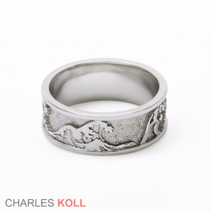 Inspired, in part, by work of the Japanese artist Katsushika Hokusai from the 19th Century this wedding band is truly one of a kind.