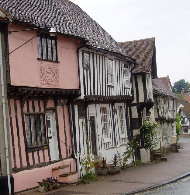 """Lavenham, Suffolk. Most people are drawn to this attractive Suffolk town by the profusion of half-timbered medieval cottages. Lavenham has been called """"the most complete medieval town in Britain"""", a tribute to its fine collection of medieval and Tudor architecture. Mansions of wealthy merchants mingle with simple cottages, some of which mix crooked timber beams with sprightly pink-painted infill!"""