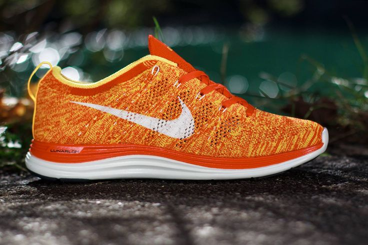 "The latest addition to the Nike Flyknit Lunar 1+ colorways is this ""Team Orange/Laser Orange"" number. This rendition features an orange knit upper, white Dynamic Flywire supports and Swoosh, dark orange tongue, and yellow lining. Underneath is a two-tone midsole with dark orange up top and white below. This sunny colorway is available now at select stockists including Titolo.  Orange-ish reds, red-ish oranges, and orange-ish yellows. And... knitted. Oh, Nike, you know me so well :D"