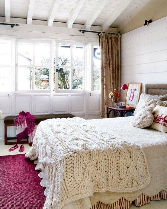killer blanket, cool idea for accent color, awesome windows and ceiling
