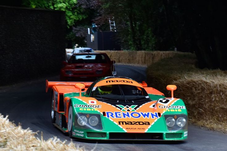 Valentino Rossi threads the Mazda 787B through the hay bails at Goodwood Festival of Speed 2015
