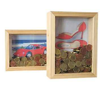 DIY: get a Shadow Box Frame and put a picture of whatever you truly want in the background; fill it with any spare change you get!  Money Bank Dream Frame