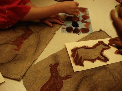 Cave art- scrunched brown paper background with colour washes, pastel etc.. To create age & cracks & texture. Cut stencil animals, stipple, blend tones. Natural ochre colours.