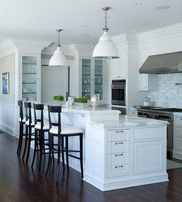 really like the peninsula end style!!!!!  Also, notice how the peninsula is set up, slight overhang on the counter top, but still space for stools, and there are cabinets on the bar stool side of the peninsula.