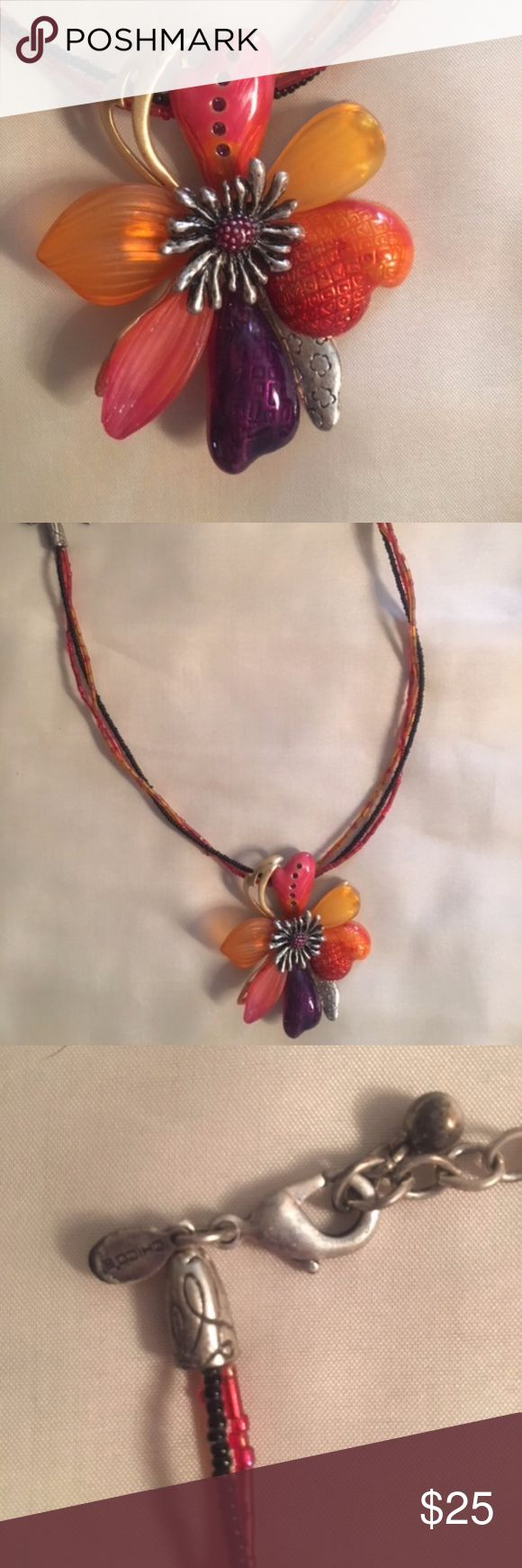 Chico's Enamel Flower pendant Necklace Statement enameled flower pendant on multi strand beaded wire with a claw clasp (Chico's tag), in shades of coral pink, purple, orange and golden yellow. Chico's Jewelry Necklaces