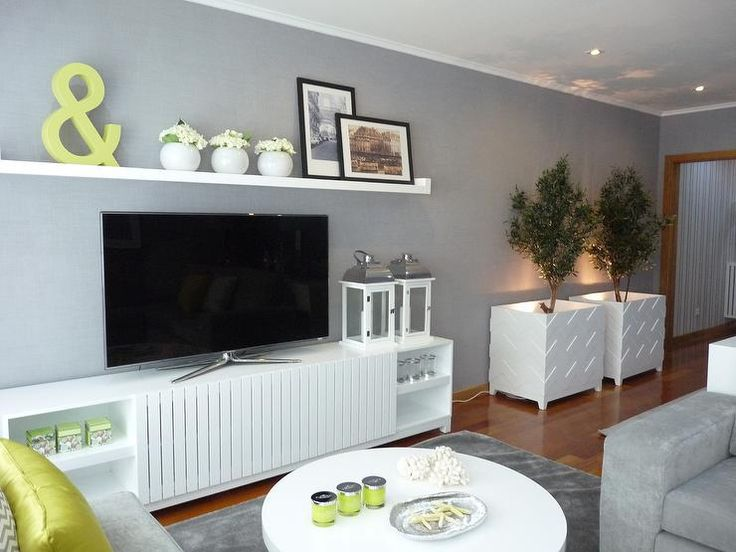 Chic common living room with grey walls and chevron white planters.