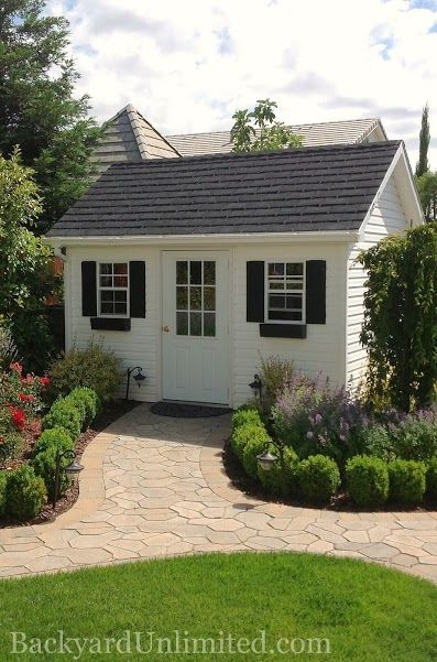 10'x12' Garden Shed with Vinyl Siding, Prehung 9-Lite Fiberglass Door,  Flower Boxes, and Rubber Slate Roof http://www.backyardunlimited.com/sheds.php