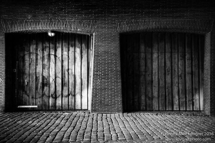 Two wooden gates and a door under the Long Brigde in Copenhagen