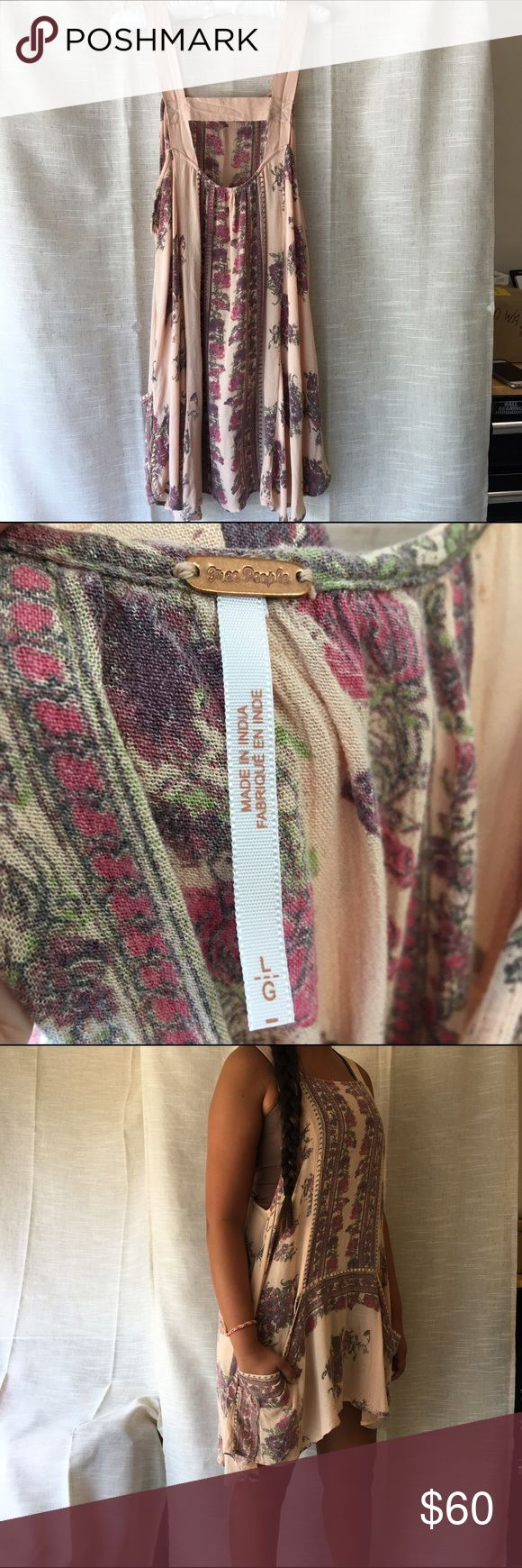 Free People dress/tunic Size Large. Can be worn as a dress or tunic. Cute worn with long sleeve top under. Soft material of 100% rayon. Fall colors. Warm peach, cranberry, olive colors. Has front pockets. Free People Dresses