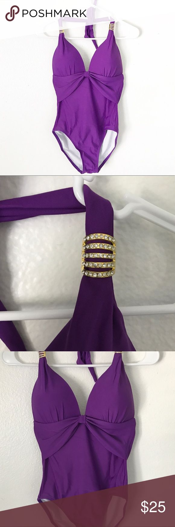 Purple one piece bathing suit Brand new beautiful purple one piece bathing suit. Low-v neck style. And lower back. Adjustable neck tie. Gold rhinestone hardware design that are removable. Swim One Pieces
