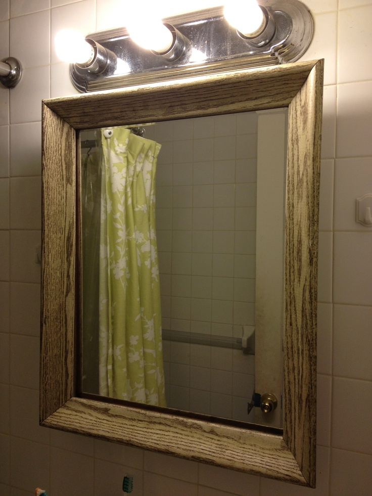 used a cheap wooden frame on my boring bathroom medicine cabinet